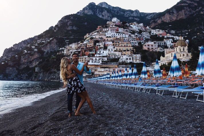 couples coordinates dancing on positano beach start here feature image