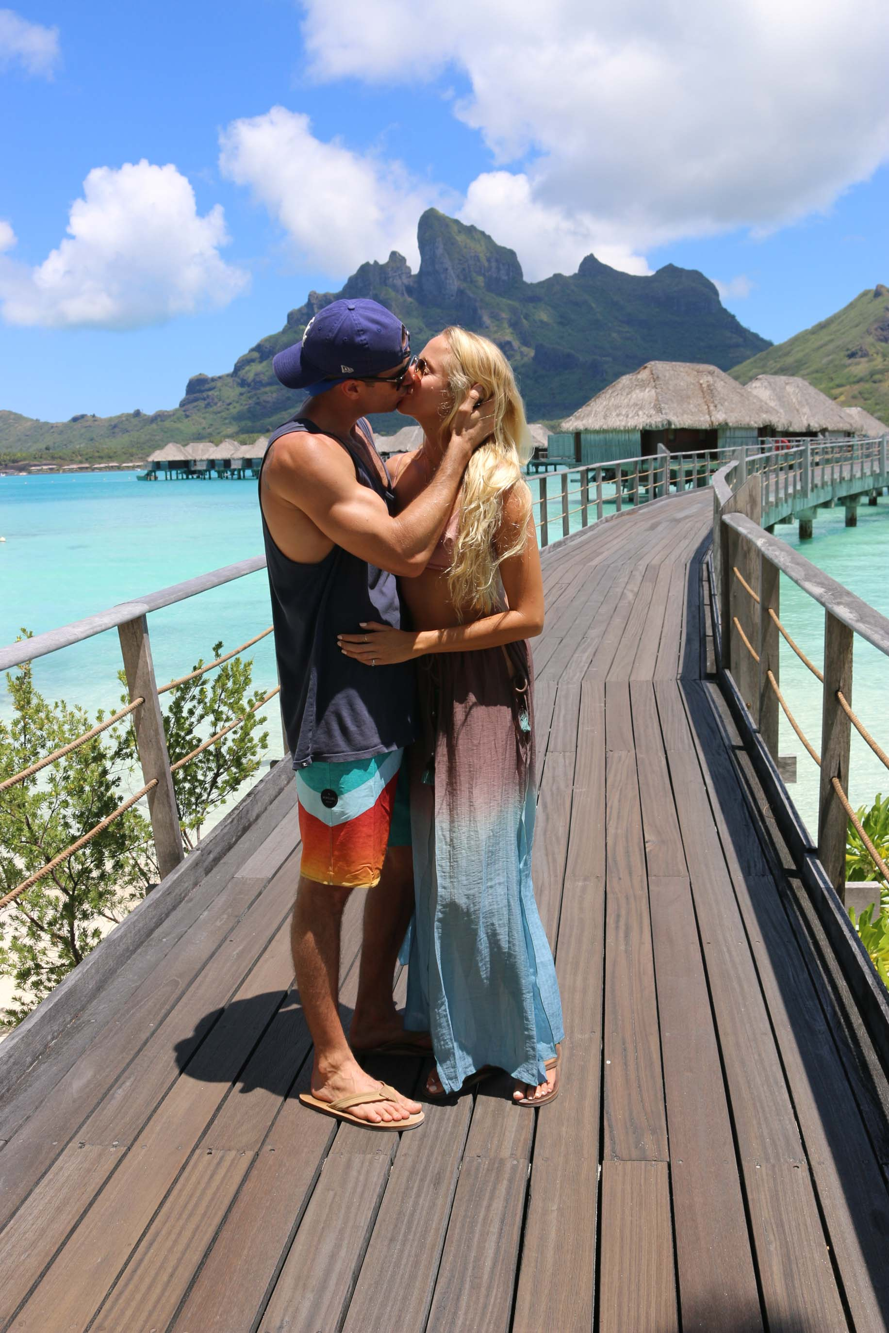 couples coordinates bora bora honeymoon guide michael and alex kissing four seasons bora bora