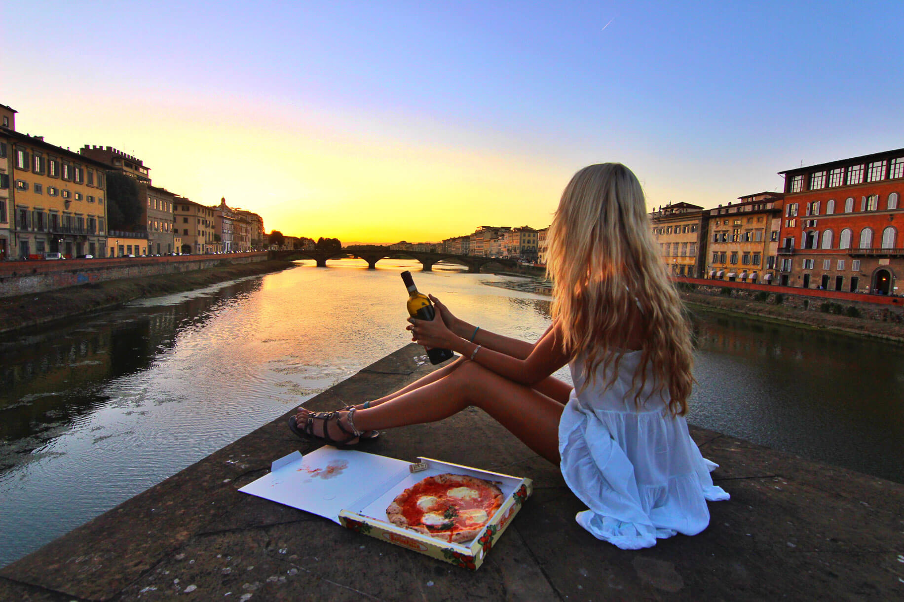 couples coordinates italy wedding destinations alex with pizza and wine over the arno river florence sunset