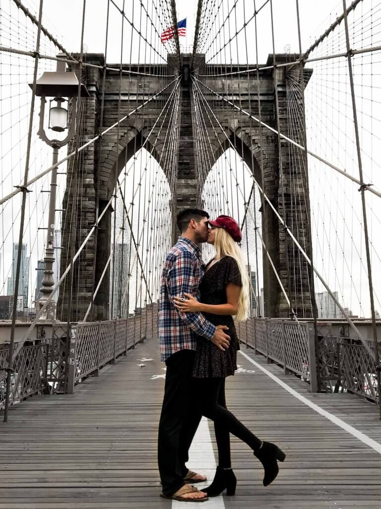 kissing on the brooklyn bridge new york nyc