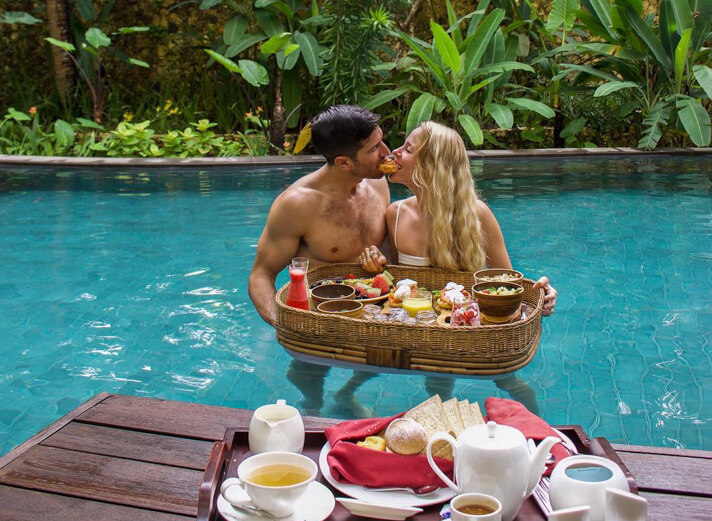 couples coordinates ritz carlton bali nusa dua floating breakfast