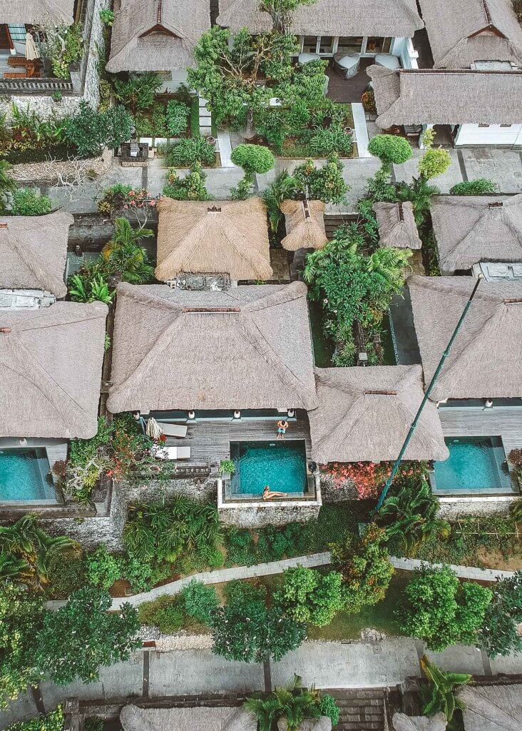 couples coordinates staying at four seasons bali four seasons jimbaran bay dji drone shot of villa