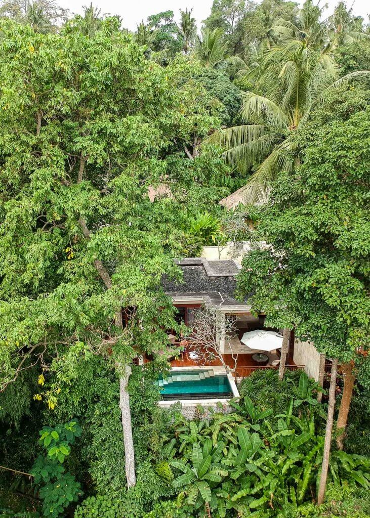 couples coordinates staying at four seasons bali four seasons sayan drone shot of room villa with private pool