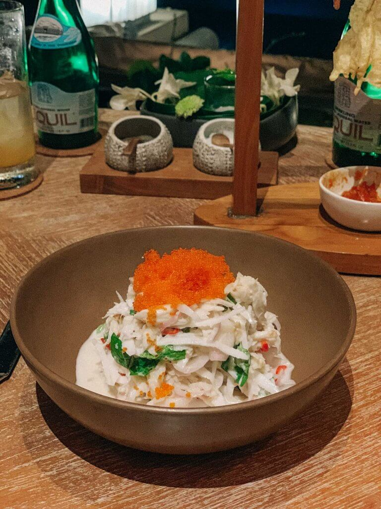 couples coordinates staying at four seasons bali sundara coconut crab salad