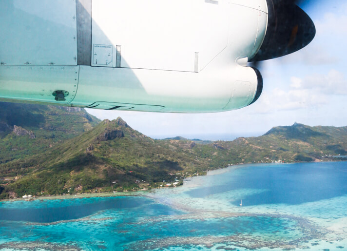 couples coordinates four seasons bora bora review view out of plane window over bora bora