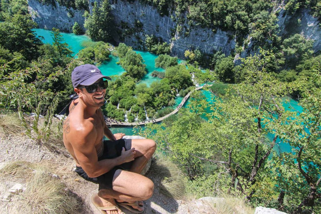 less traveled destinations michael sitting at plitvice lakes croatia