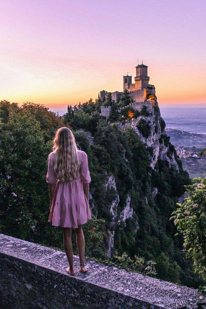 alex at castello della guaita san marino at sunset with beautiful view over rimini italy