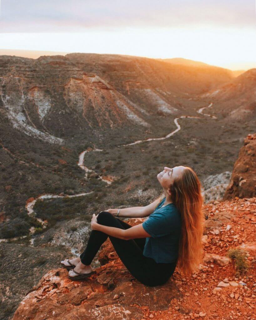 alex at charles knife canyon sunrise over the gorge cape range national park